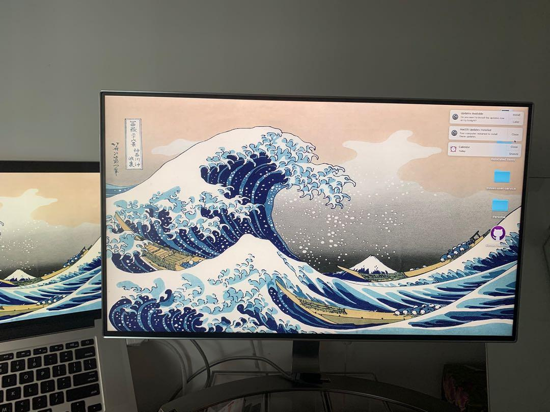 LG 23.8 inch screen monitor in silver