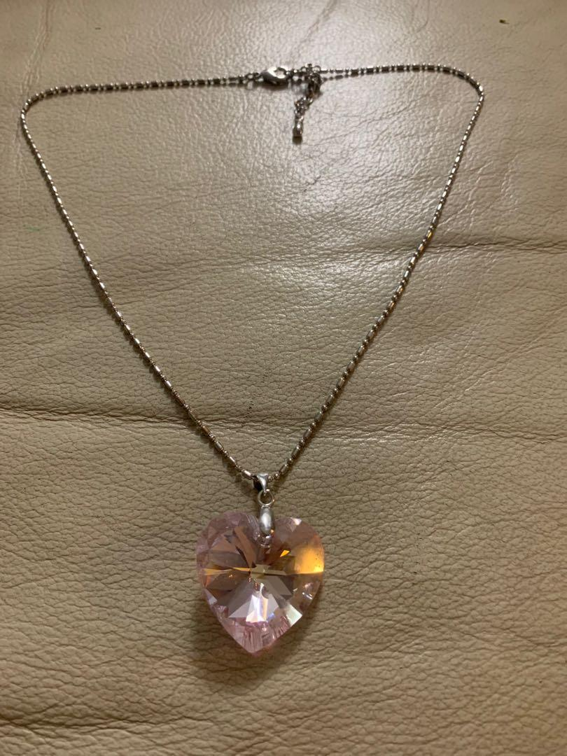 Necklace with pink heart pendant