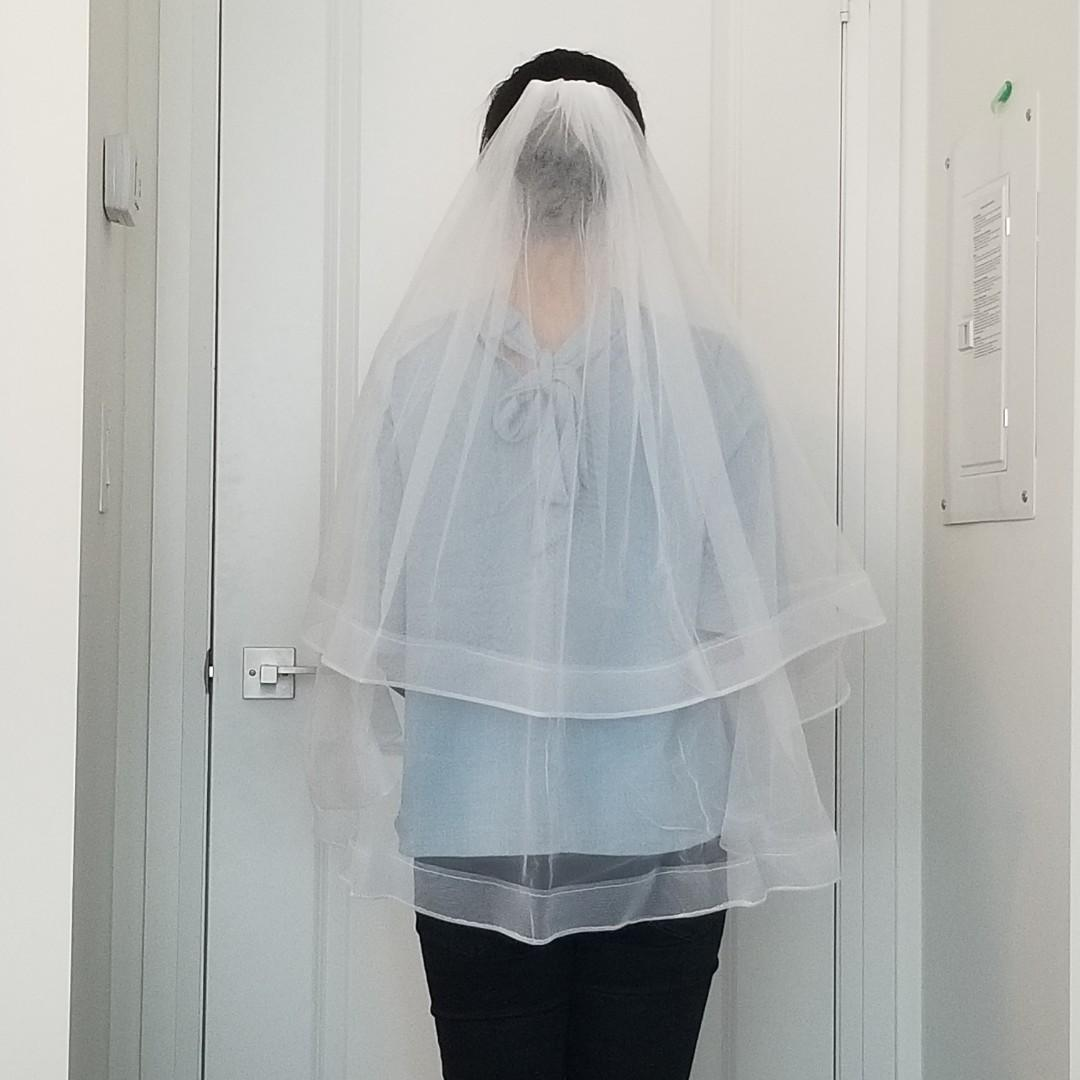 Brand new two layer wedding veil with comb
