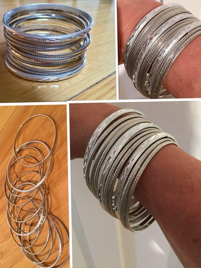 12 BRAND NEW sparkly silver tone bangles bought in Strasbourg,France