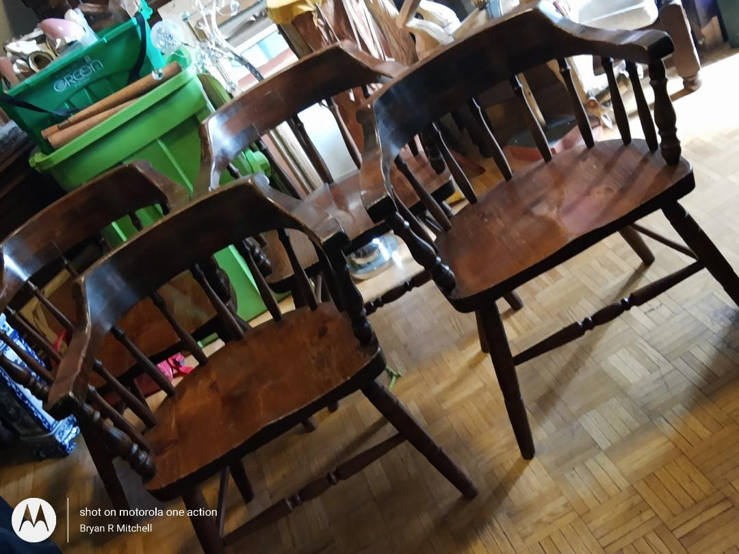 Four barrelback solid wood chairs