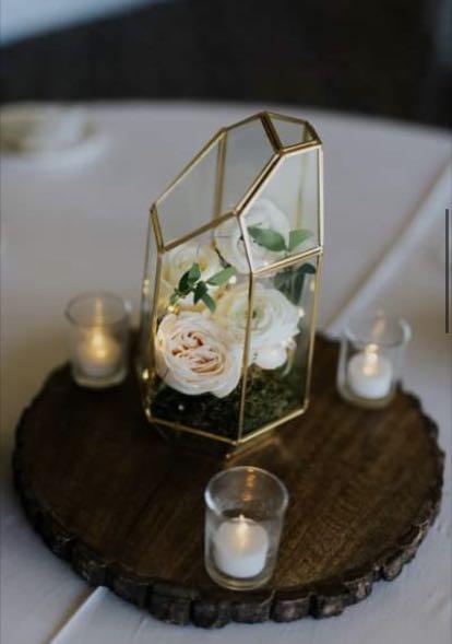Raw-edge wooden serving plate used as a wedding centrepiece base