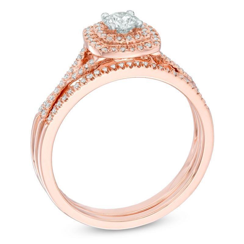 14 karat Diamond rose gold engagement ring with matching fitted 14 karat rose gold wedding ban