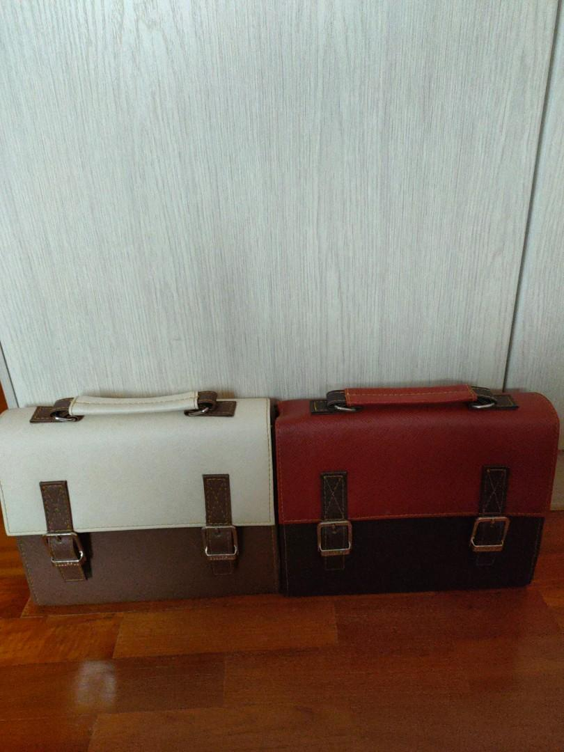 2 Sling and hand carry handbags