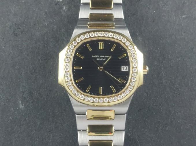 Patek Philippe Nautilus Ladies Quartz 18 ct. Yellow Gold / Stainless Steel Custom Diamond Bezel 3900