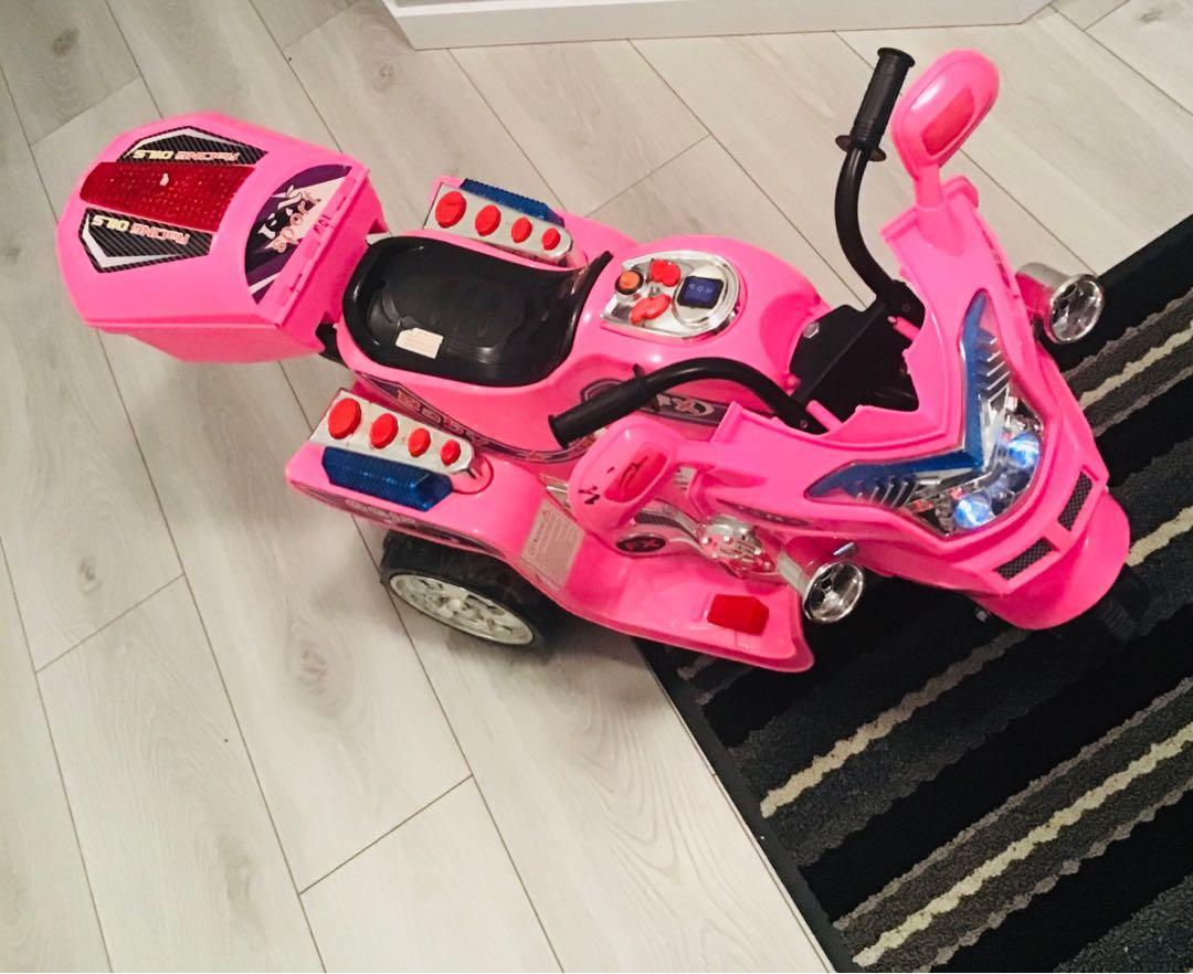Pink electric toy motorcycle for sale