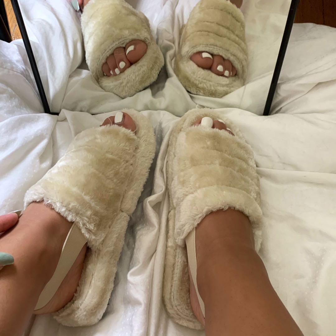 beige furry slides