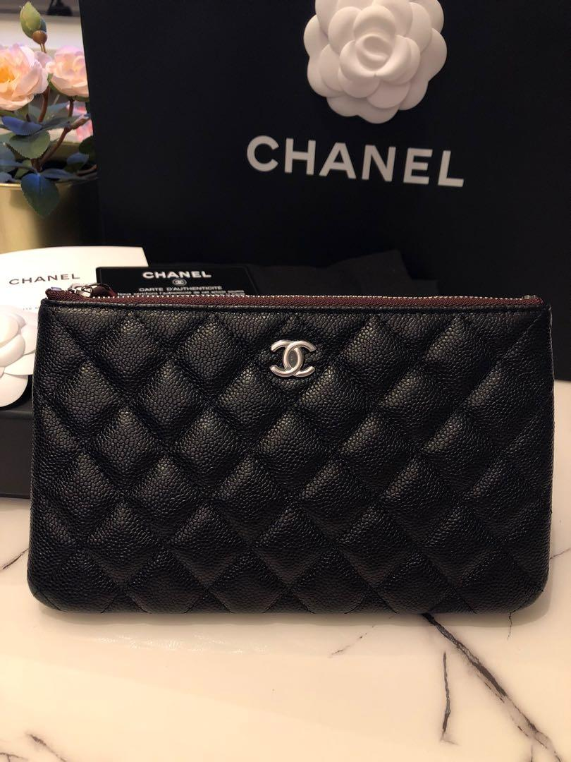 Brand new Chanel small o case black caviar silver hardware with seal intact
