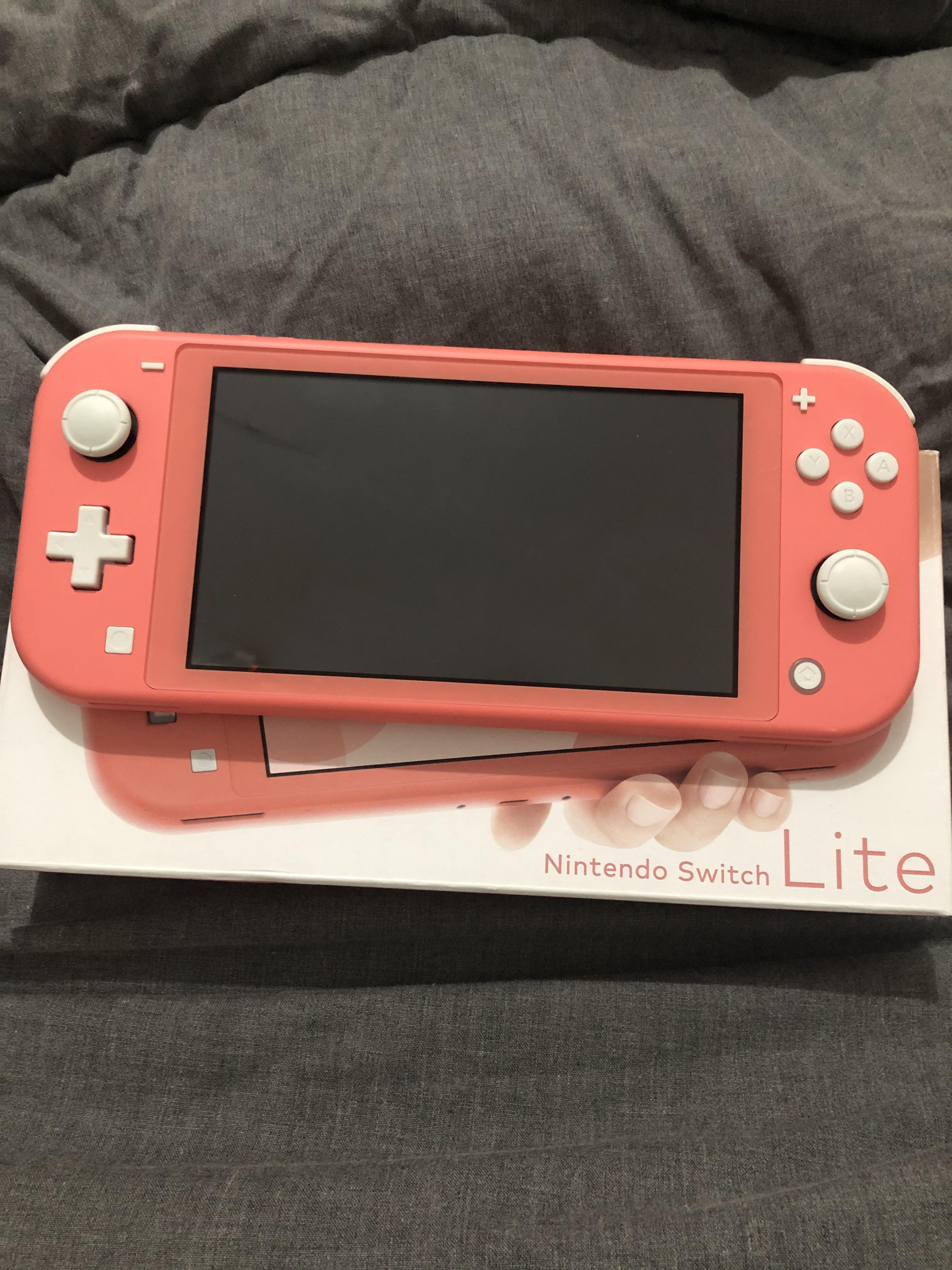 NINTENDO SWITCH LITE CORAL INCLUDE GAME ( Animal Crossing New Horizon)