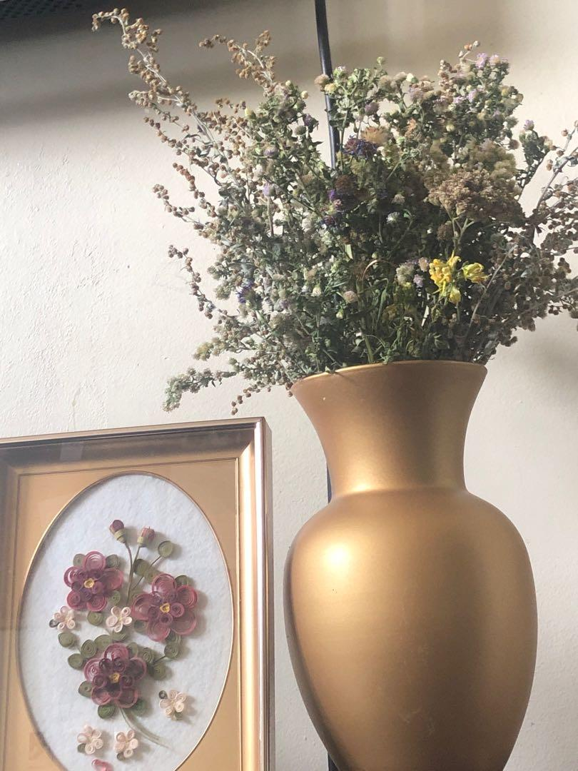 stunning dried floral arrangement with gold vase