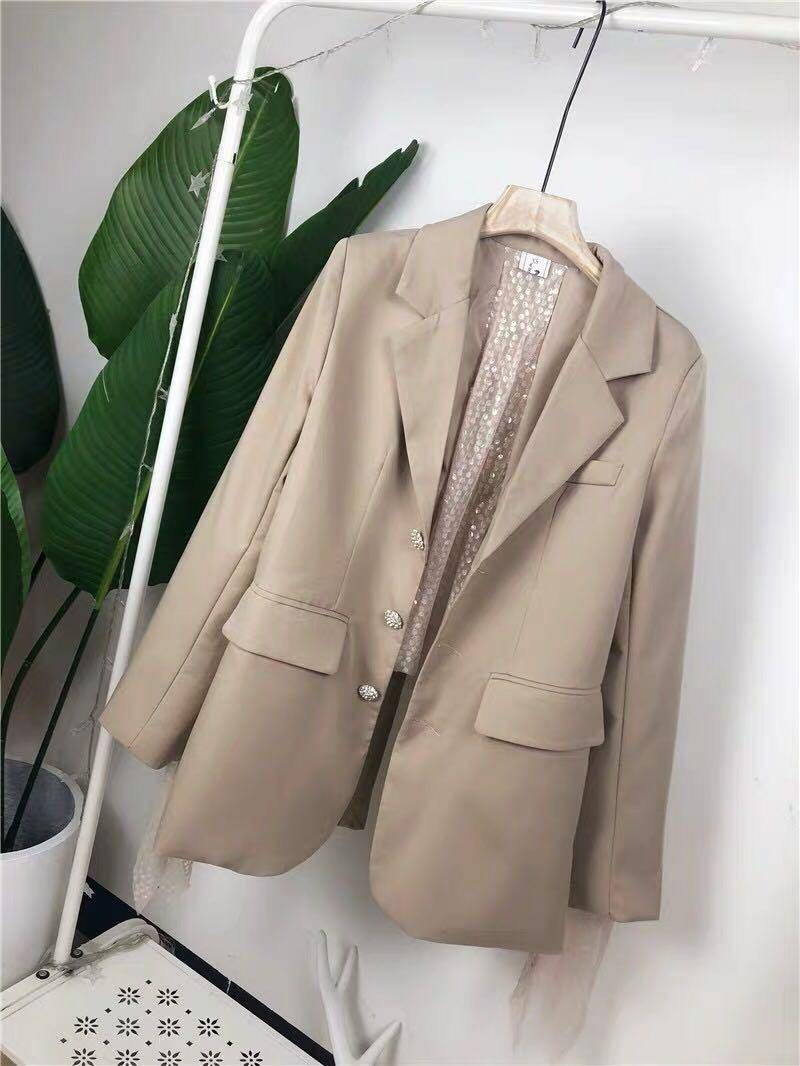 Woman's clothing jacket