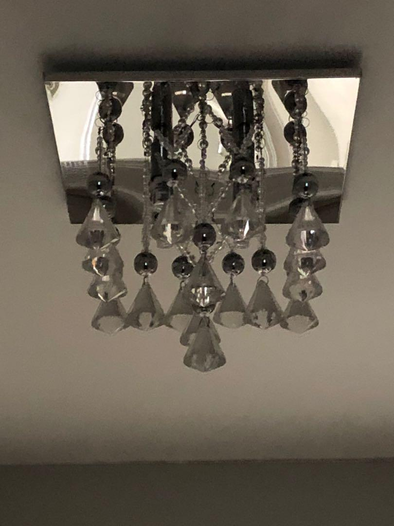 A pair of  fixed ceiling lights