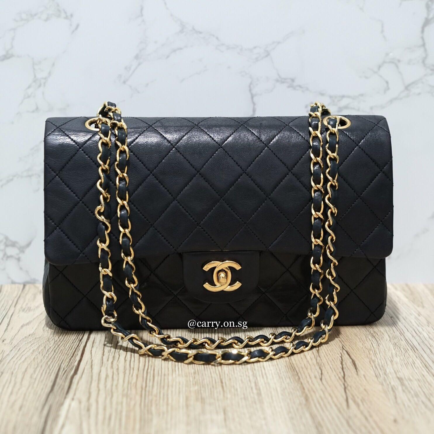 Chanel Classic 10in Medium Double Flap bag in Black Lambskin with 24k Goldhardware