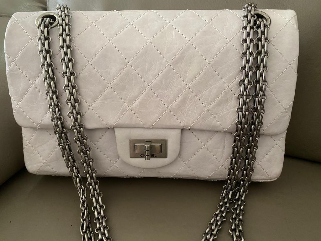 Well kept unused Chanel 2.55 mini reissue bag in aged calfskin leather