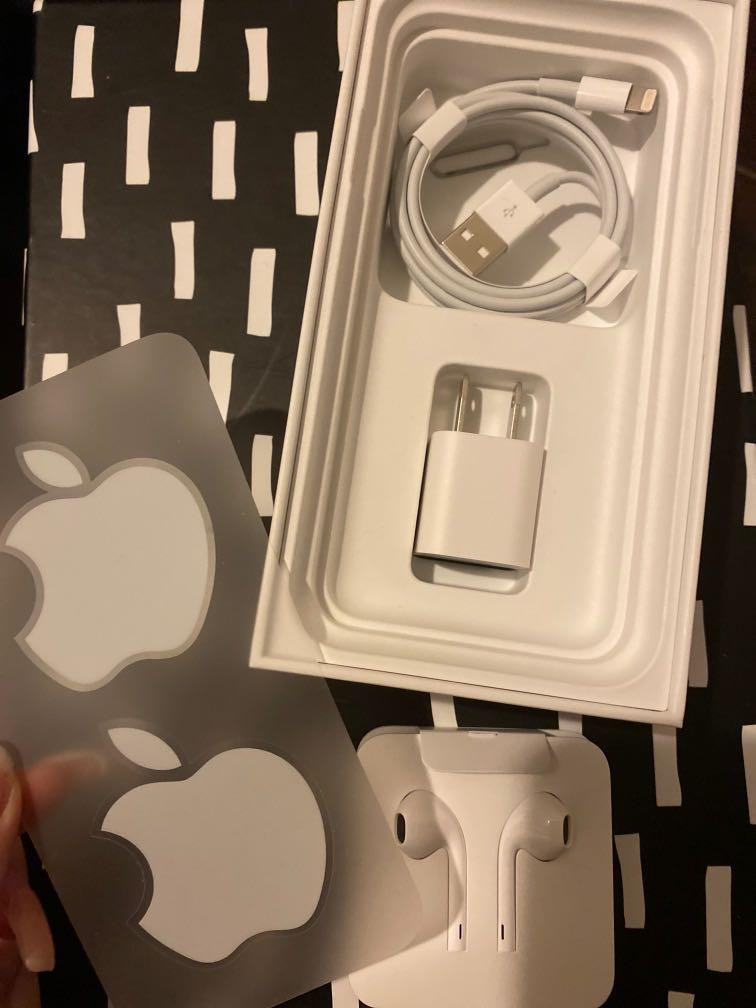 A set of Apple charger and earpods