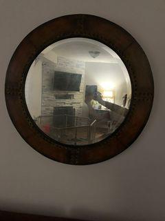 Having round mirror and storage ottoman
