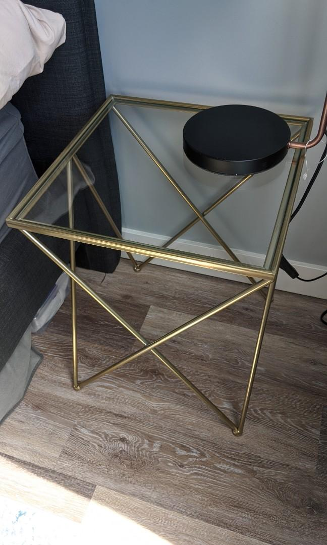 Gold side table /night stand with glass top and metal legs