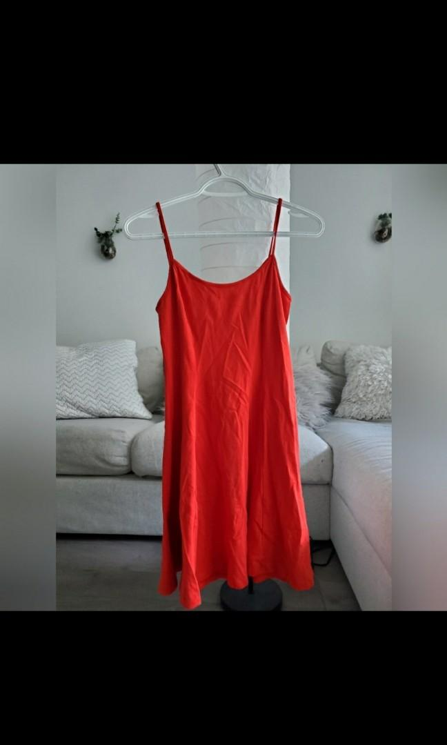 Plain red dress with bow keyhole in back.