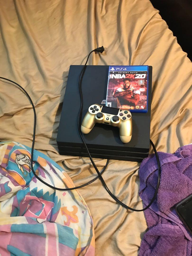 PlayStation 4 with controller and NBA 2k20
