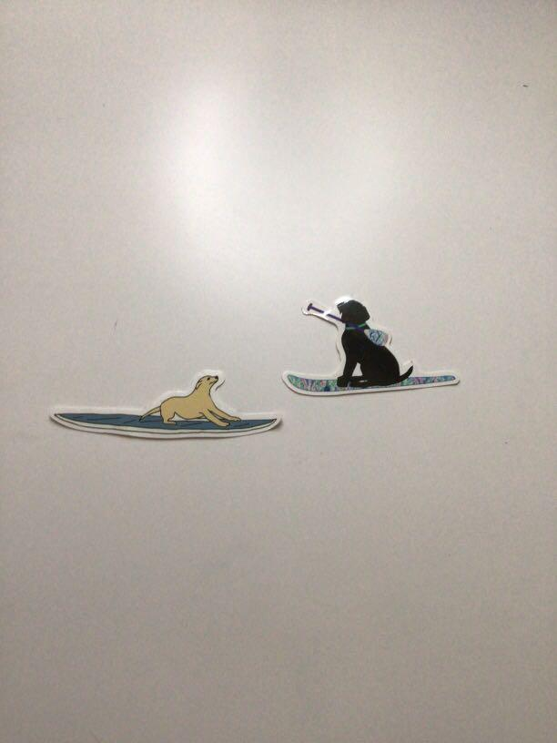 2 dog stickers on a board