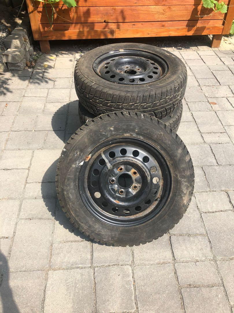 4 Steel Rims with 2 Kumho Winter Tires