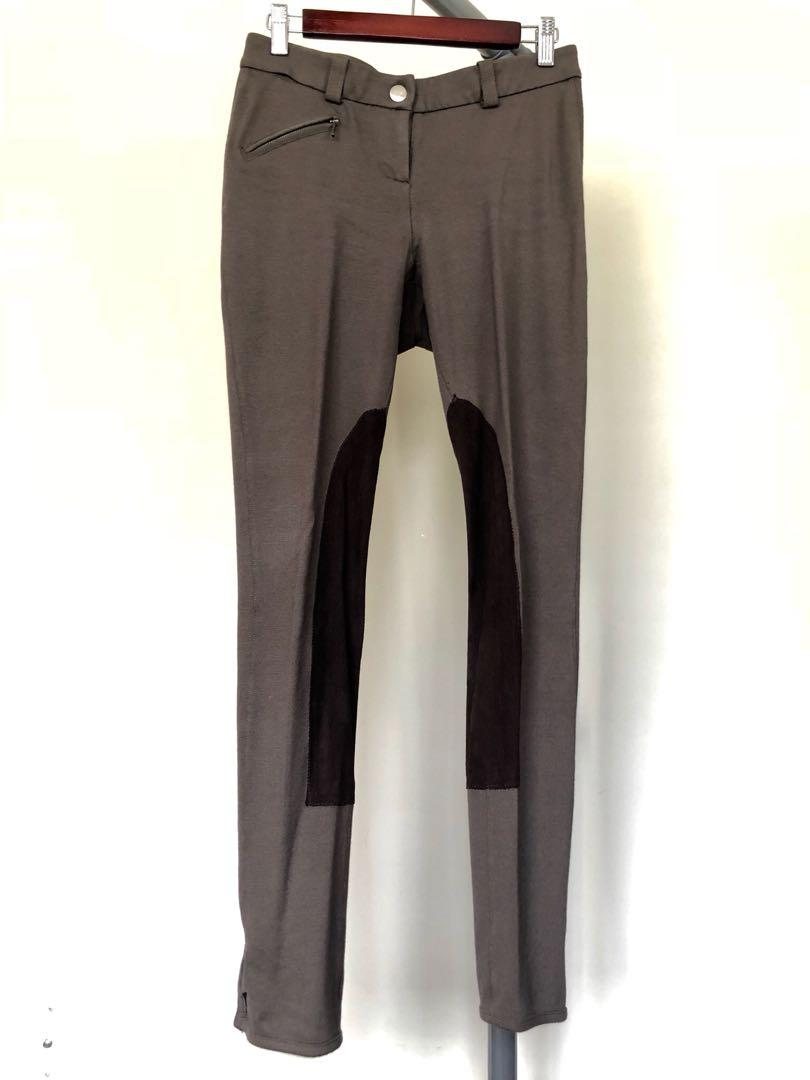Brown riding-style pants. Size 4. Cotton with detail.