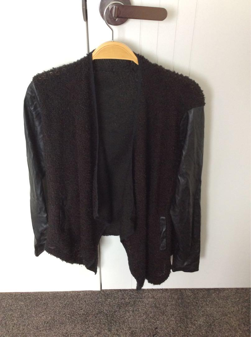 Jacket with faux leather sleeve