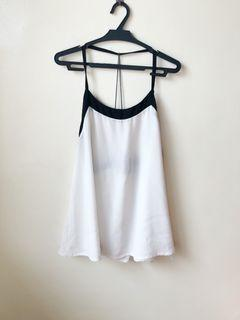 White sleeveless top with a back string detail