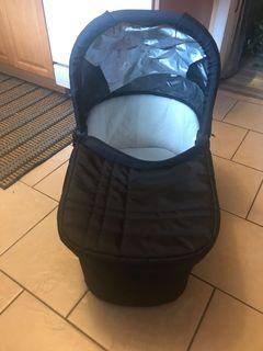 Looks like new it is uppababy brand bassinet