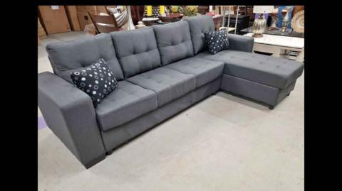 Brand new in box sectional with storage