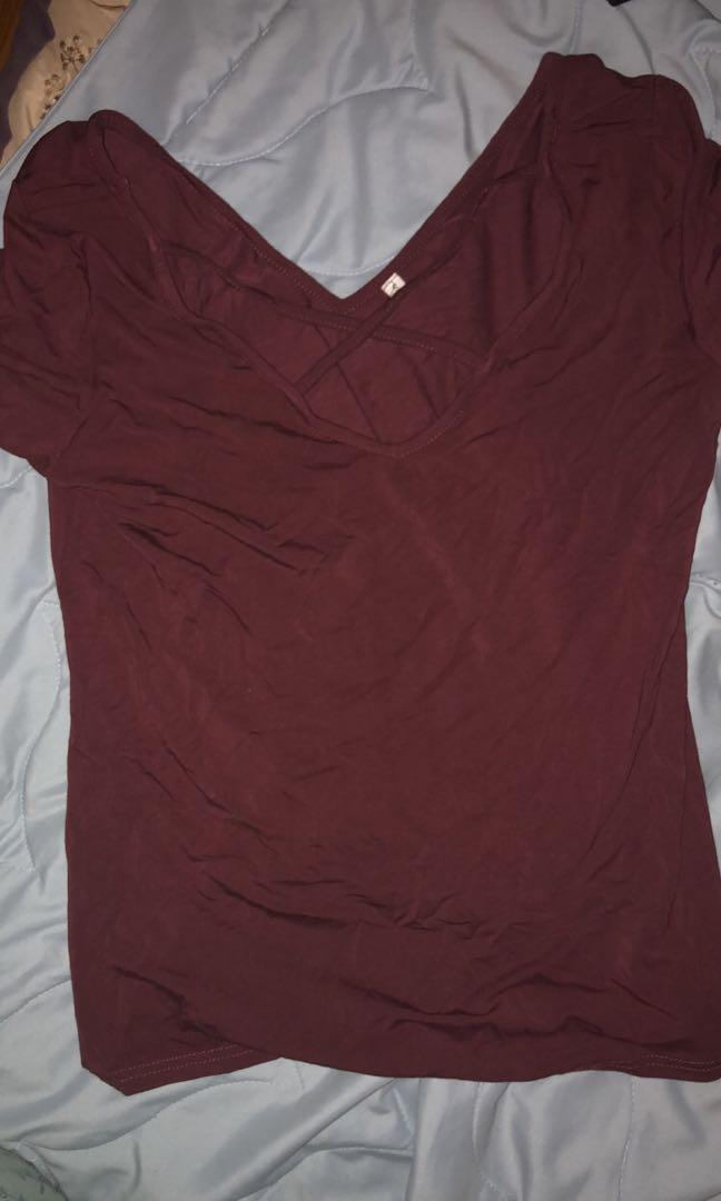Burgundy top with v neck criss cross design