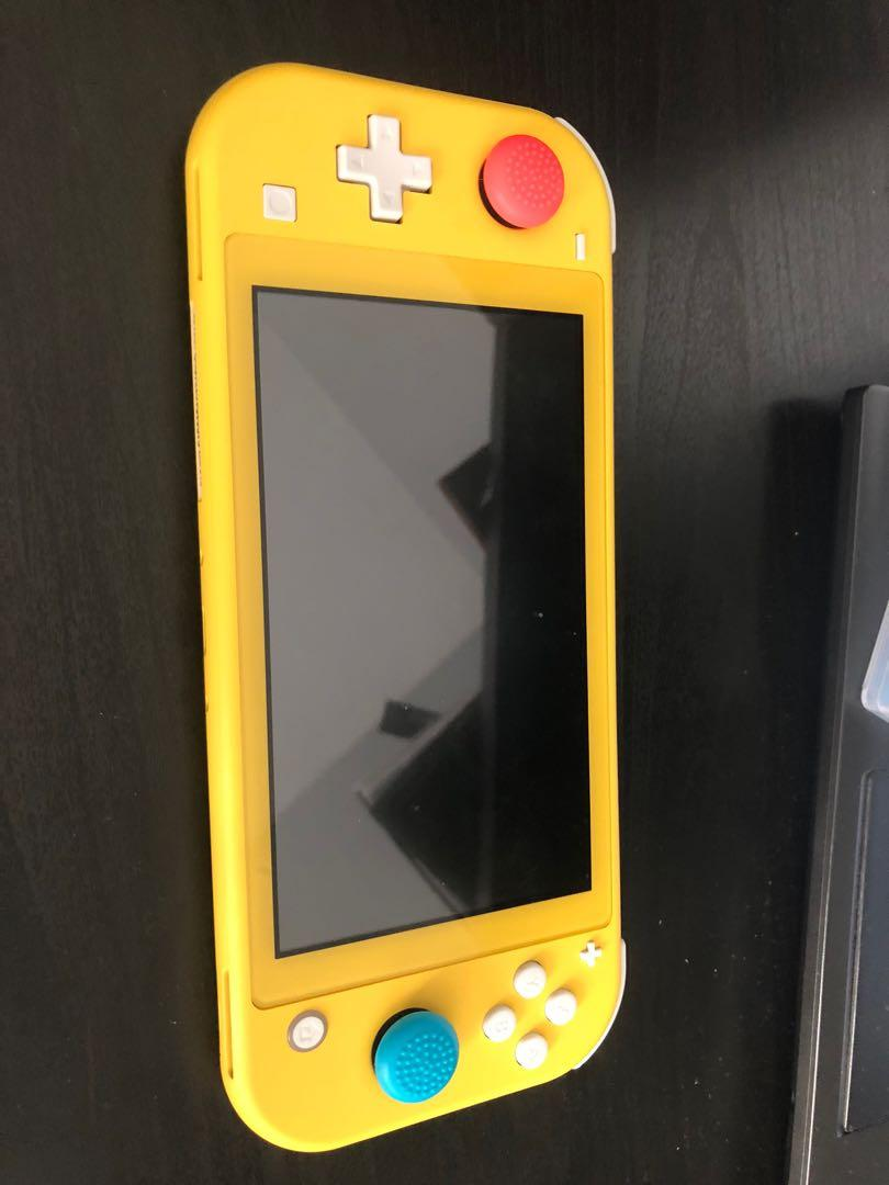 Nintendo switch lite and animal crossing game card
