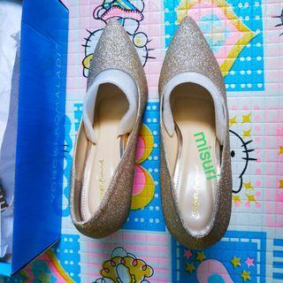 Gold heels Yongki Komaladi
