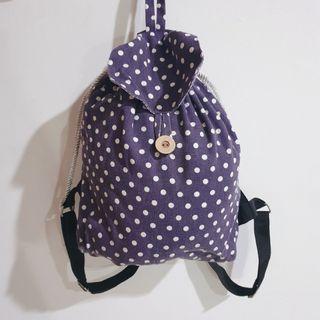 Purple polkadot string bag