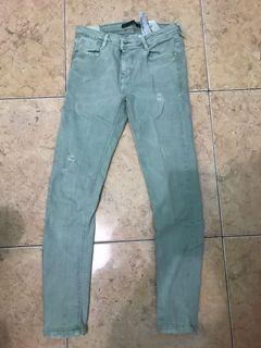 zara ripped green jeans