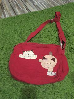 布貓側背包