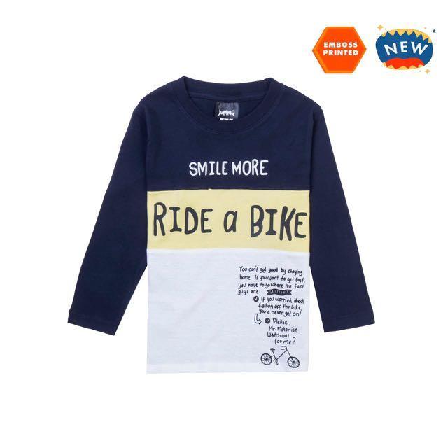 Jummakids ride a bike