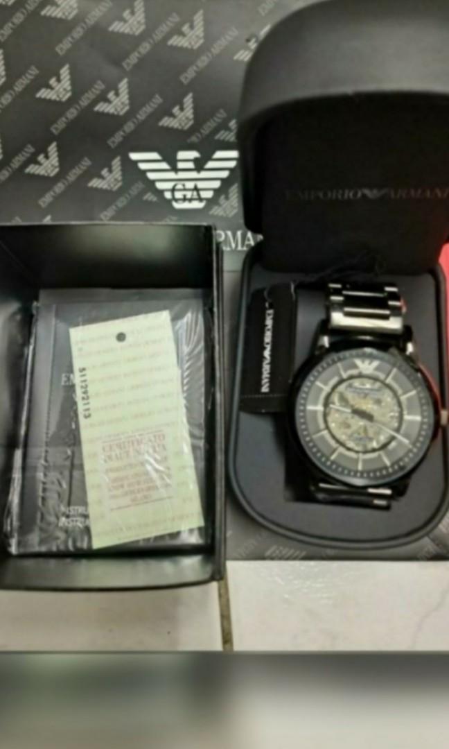 全新  阿曼尼 鏤空機械鋼帶錶(男錶)