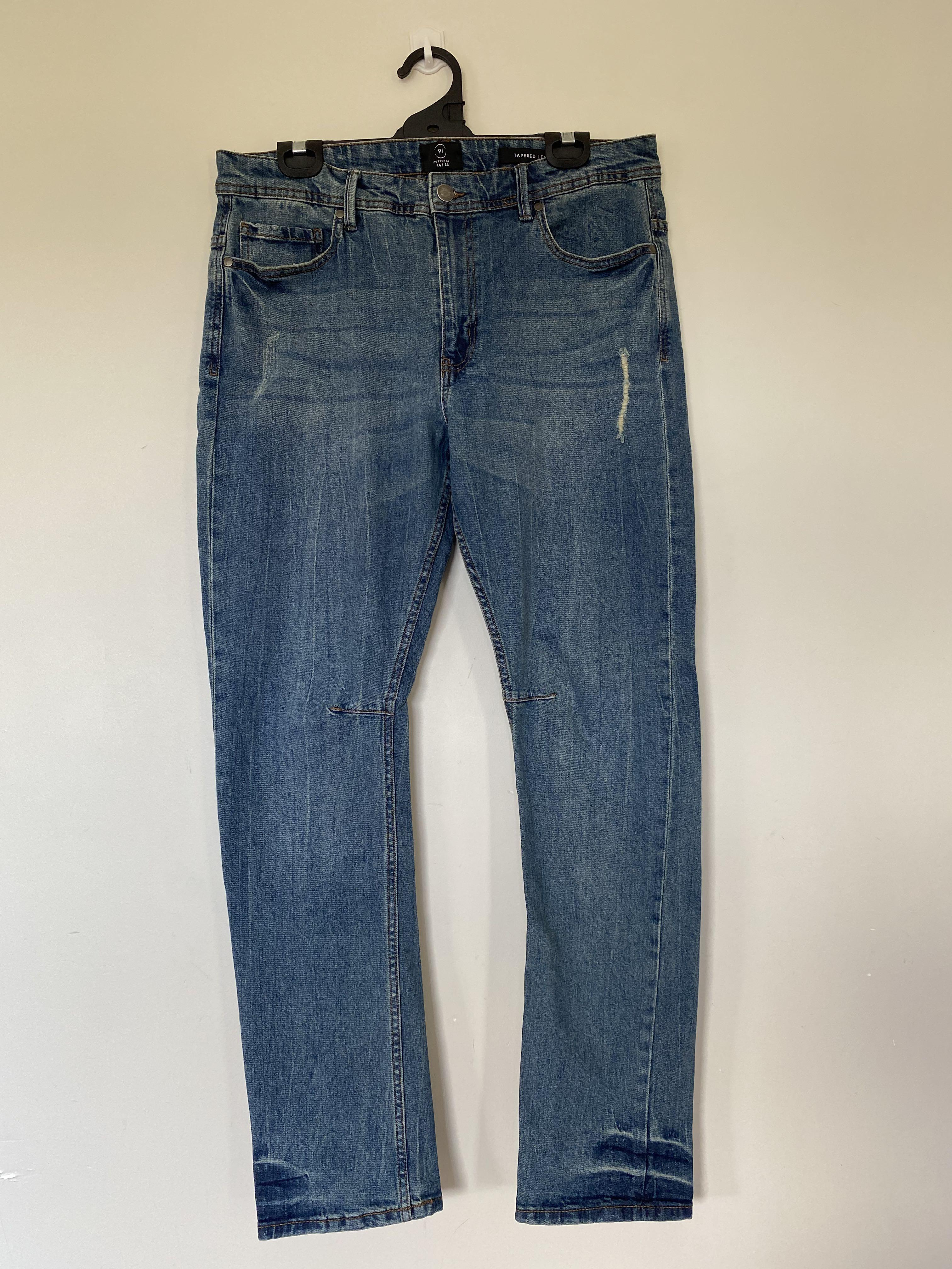 Wash Out Dark Blue Tapered Leg Jean