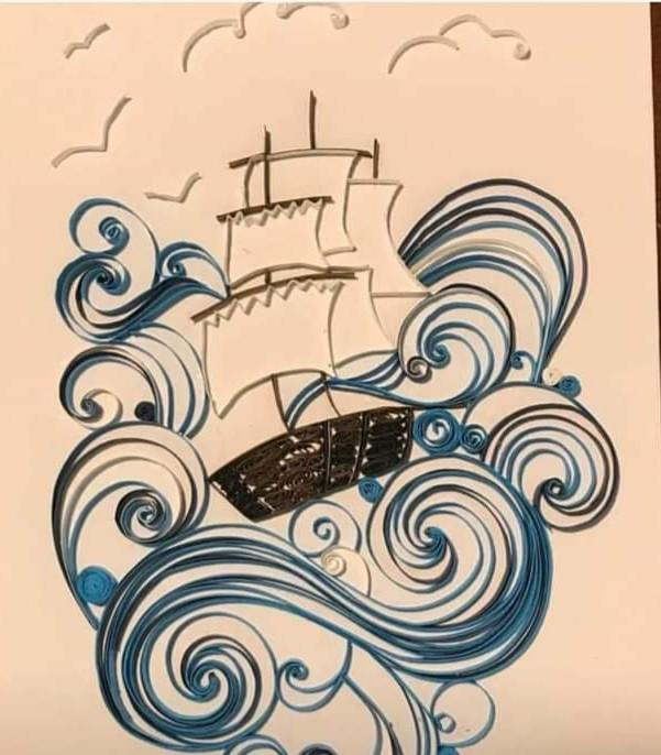 Boat between waves made with technique quilling.
