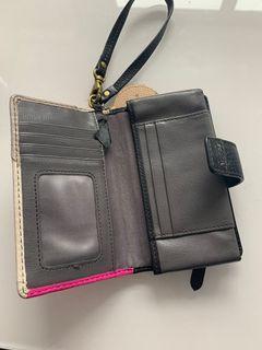 Fossil phone wallet with Estée Lauder fox keychain
