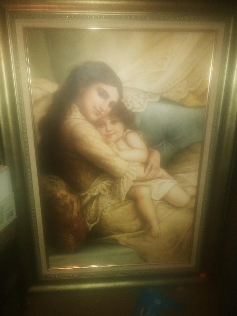 Mother holds child Oil/Canvas D Leon