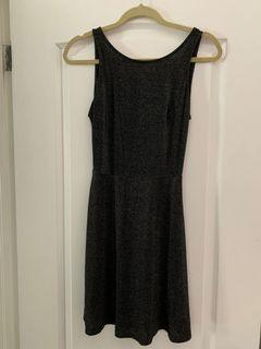 Sparkly mini dress with V shaped back in size 6