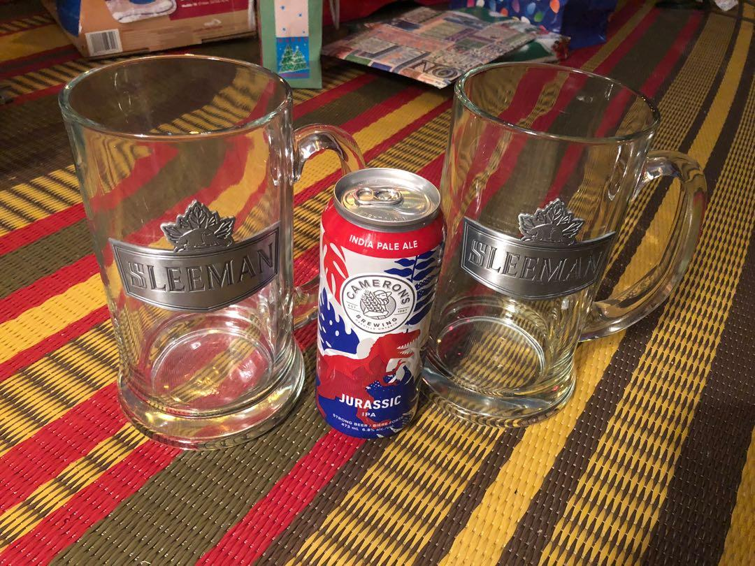 Two huge collectible Sleeman glass beer steins