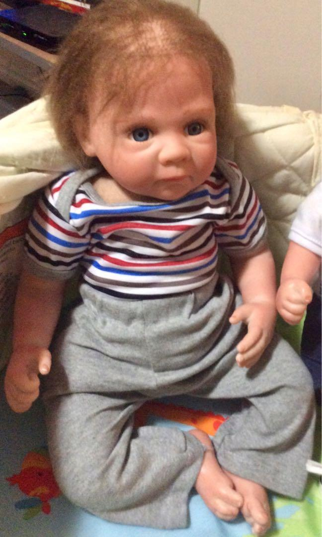 OtardDolls 22'' Toddlers Boys Silicone Realistic Baby Dolls Magnetic Toy That Look Real Eyes