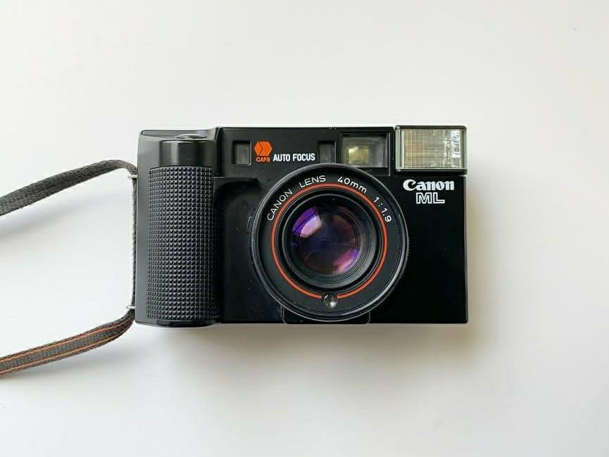 CANON AF35 ML with free 2 AA panasonic rechargeable battery and 1 fuji c200 film