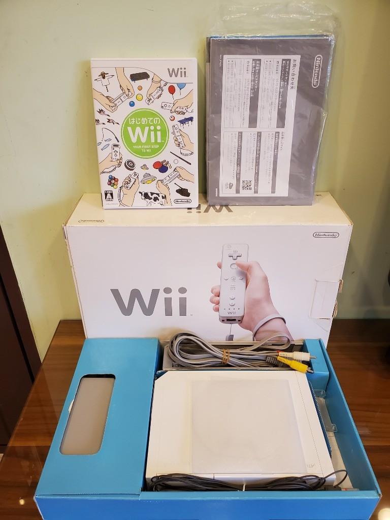Wii主機組 + 左右手搖桿(附動感器) + Wii 第一次接觸