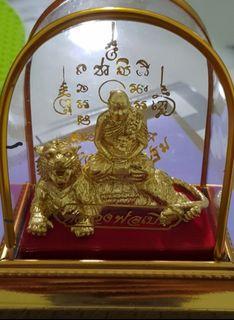 LP Pern sitting on Tiger