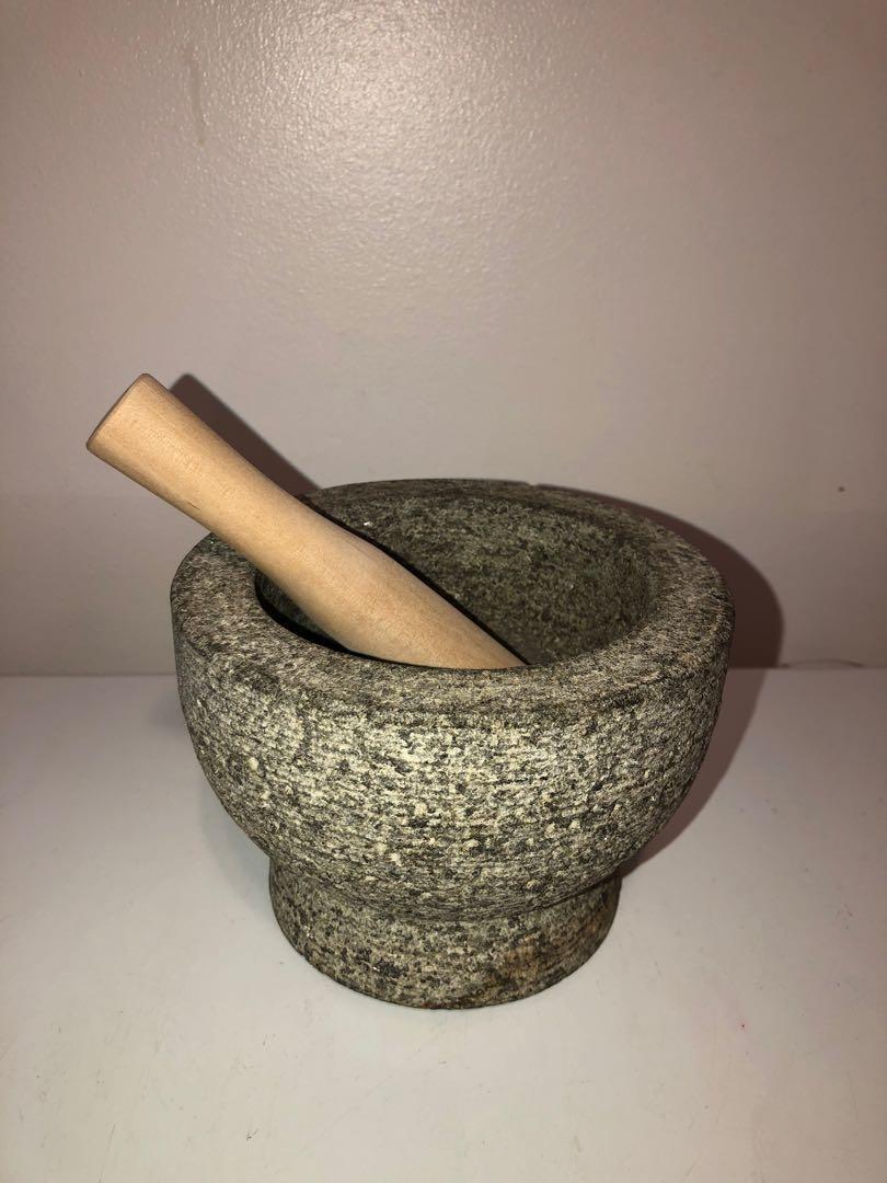 Vintage granite stone mortar and wooden pestle