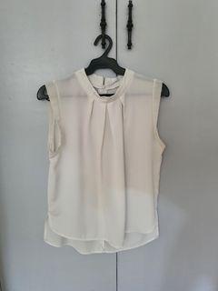 White mock neck sleeveless blouse